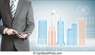 Businessman with tablet pc. High-tech skyscrapers