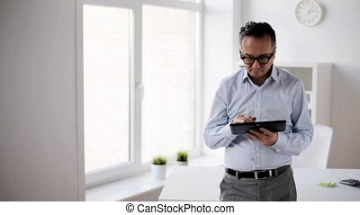 businessman with tablet pc in office - business, people and...