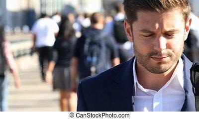 Businessman With Takeaway Drink Walking To Work In Slow...