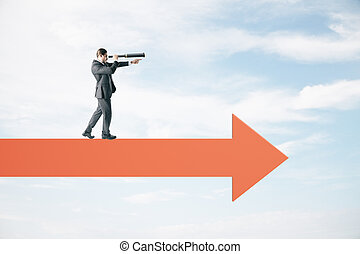 Businessman with telescope standing on abstract arrow