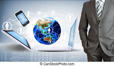 Businessman with the earth and electronics
