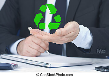 businessman with the symbol of recycling
