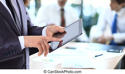 Businessman with the tablet.