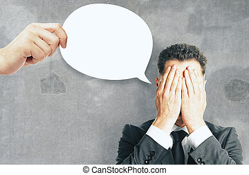 Businessman with thought/speech bubble