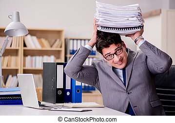 Businessman with too much paperwork