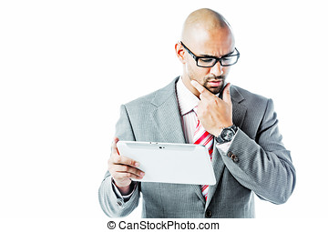 Businessman with touchpad holding his chin