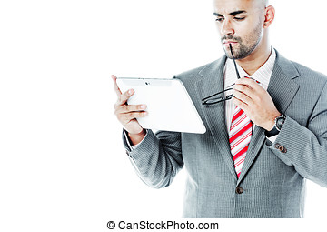 Businessman with touchpad holding his glasses