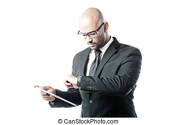 Businessman with touchpad looking at his clock