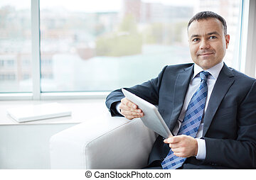 Businessman with touchpad