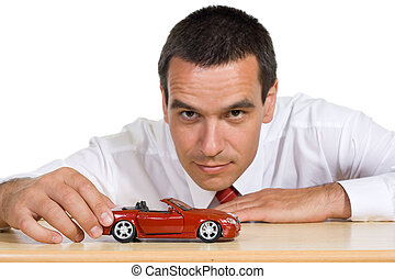 Businessman with toy car - isolated