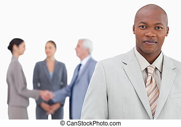 Businessman with trading partners behind him