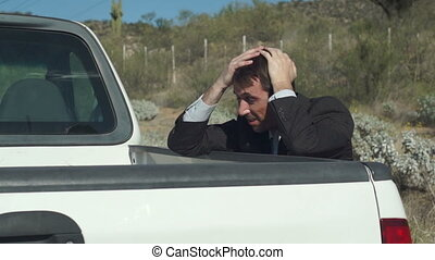 Businessman With Truck Broken Down