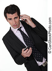Businessman with two phones.