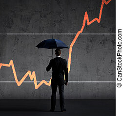 Businessman with umbrella standing over diagram background. Business, insurance, risk, concept.