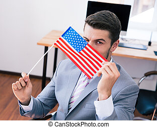 Businessman with USA flag in office