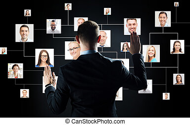 businessman with virtual contact icons