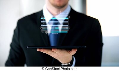 businessman with virtual projection over tablet pc -...
