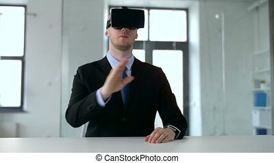 businessman with virtual reality headset at office