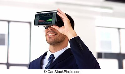 businessman with virtual reality headset at office -...