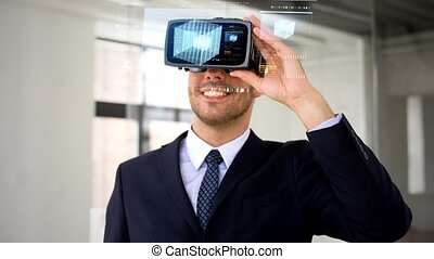businessman with vr headset and cube on screen