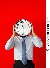 Businessman with wall clock