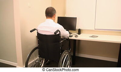 Businessman with wheelchair