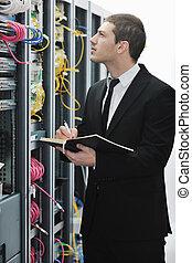 businessman withnotebook in network server room