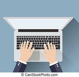Businessman working a laptop.