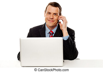 Businessman working and talking on cell phone