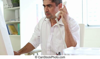 Businessman working and talking on phone
