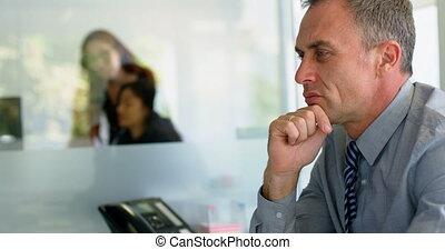 Businessman working at desk 4k