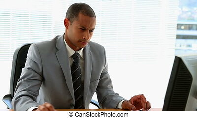Businessman working at his desk in his office