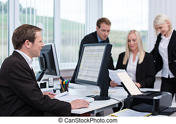Businessman working at his desk on a desktop