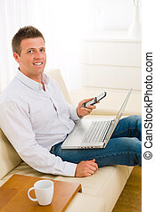 Businessman working at home - Casual businessman working at...
