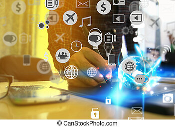 Businessman working at office desk. Social media icons interface on screen.