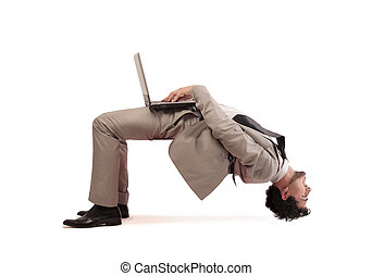 businessman working hard with laptop in weird position on white background