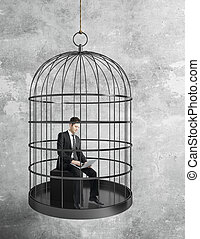 businessman working in birdcage