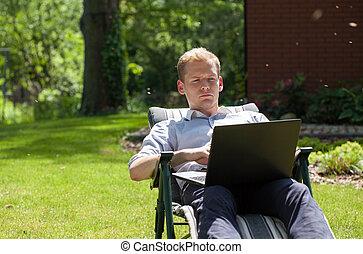 Businessman working in garden