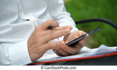 Businessman Working In The Park With Mobile Phone. Business...