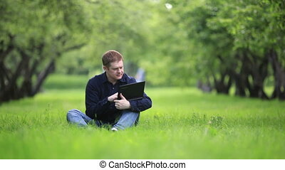 Businessman working in the park.