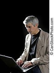 businessman working laptop, senior gray hair - businessman...