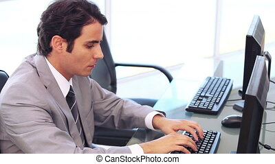 Businessman working on a computer