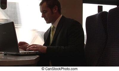 Businessman Working on a Train