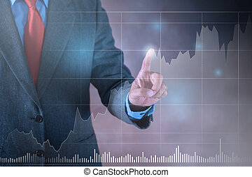 Businessman working on a virtual screen of the future. Business Stock graph concept