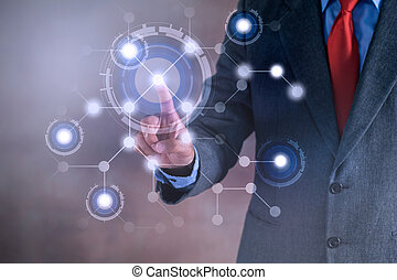 Businessman working on a virtual screen of the future. Internet and network concept