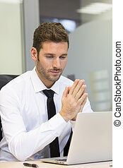 Businessman working on computer in modern office