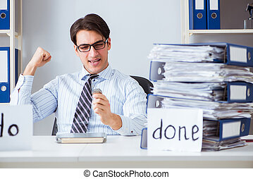 Businessman working on his to-do list