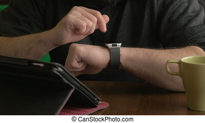 Businessman working on smart watch
