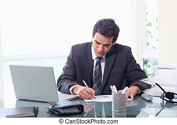 Businessman working on statistics