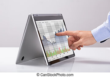 Businessman Working On Stock Chart On Hybrid Laptop